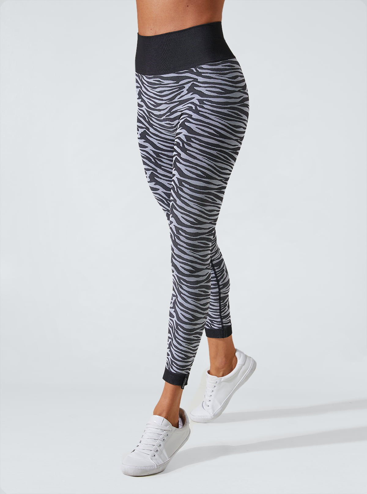 Schwarz-Weiss Zebra Animalier Leggings mit schlank machender und feuchtigkeitsspendende Wirkung